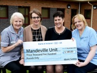 Marie makes donation to the Mandeville Unit